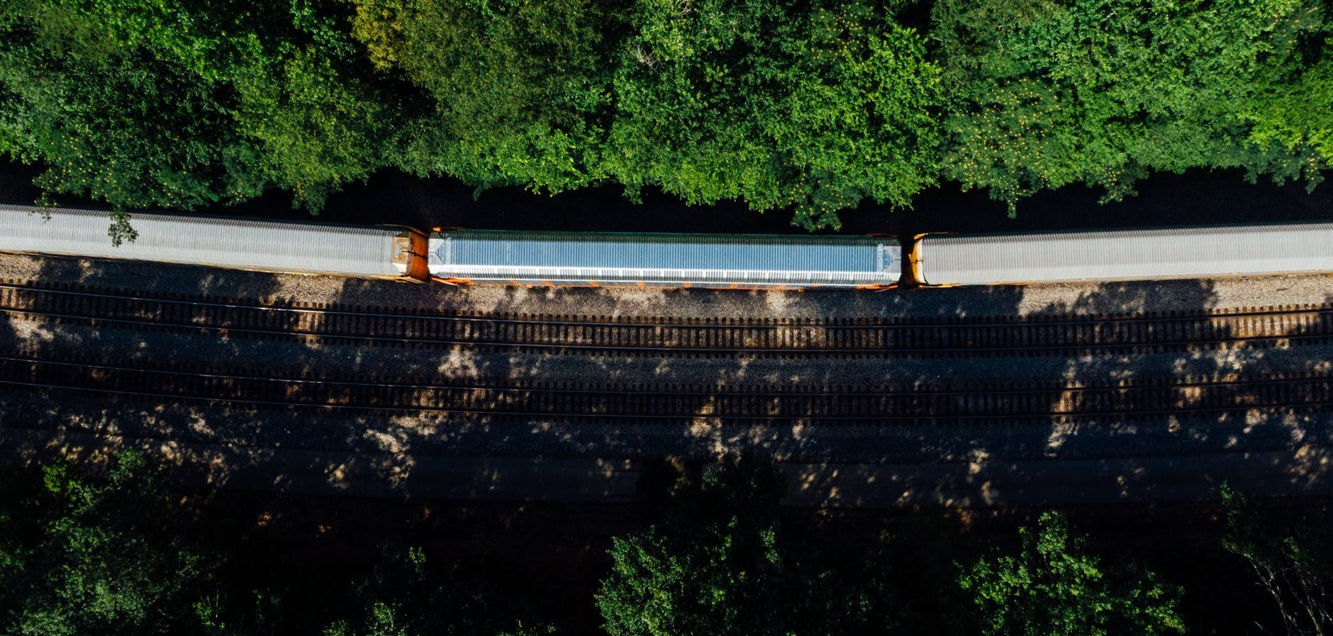top view photo of train surrounded by trees