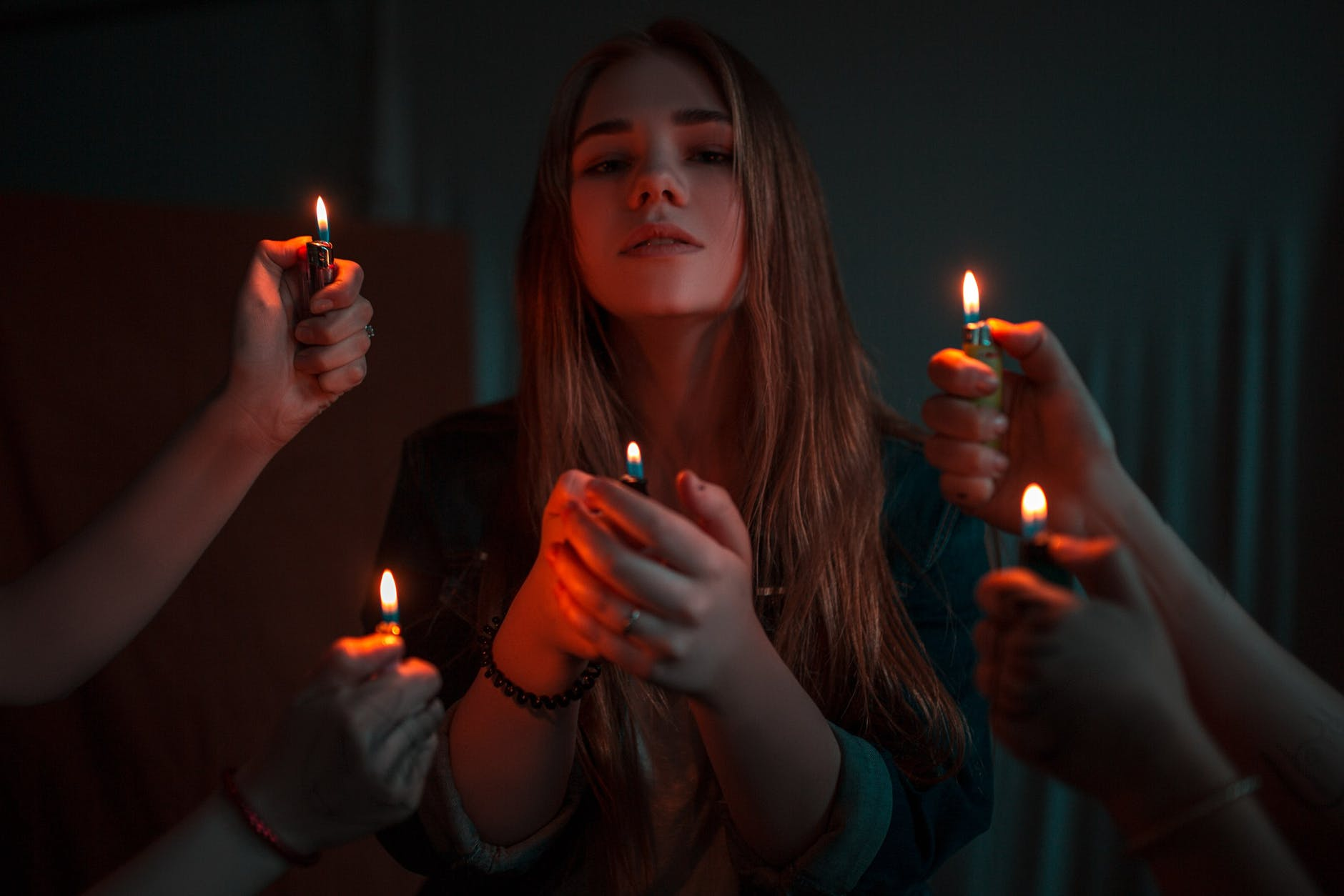 woman holding disposable lighter