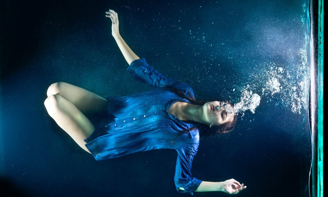 underwater photography of woman