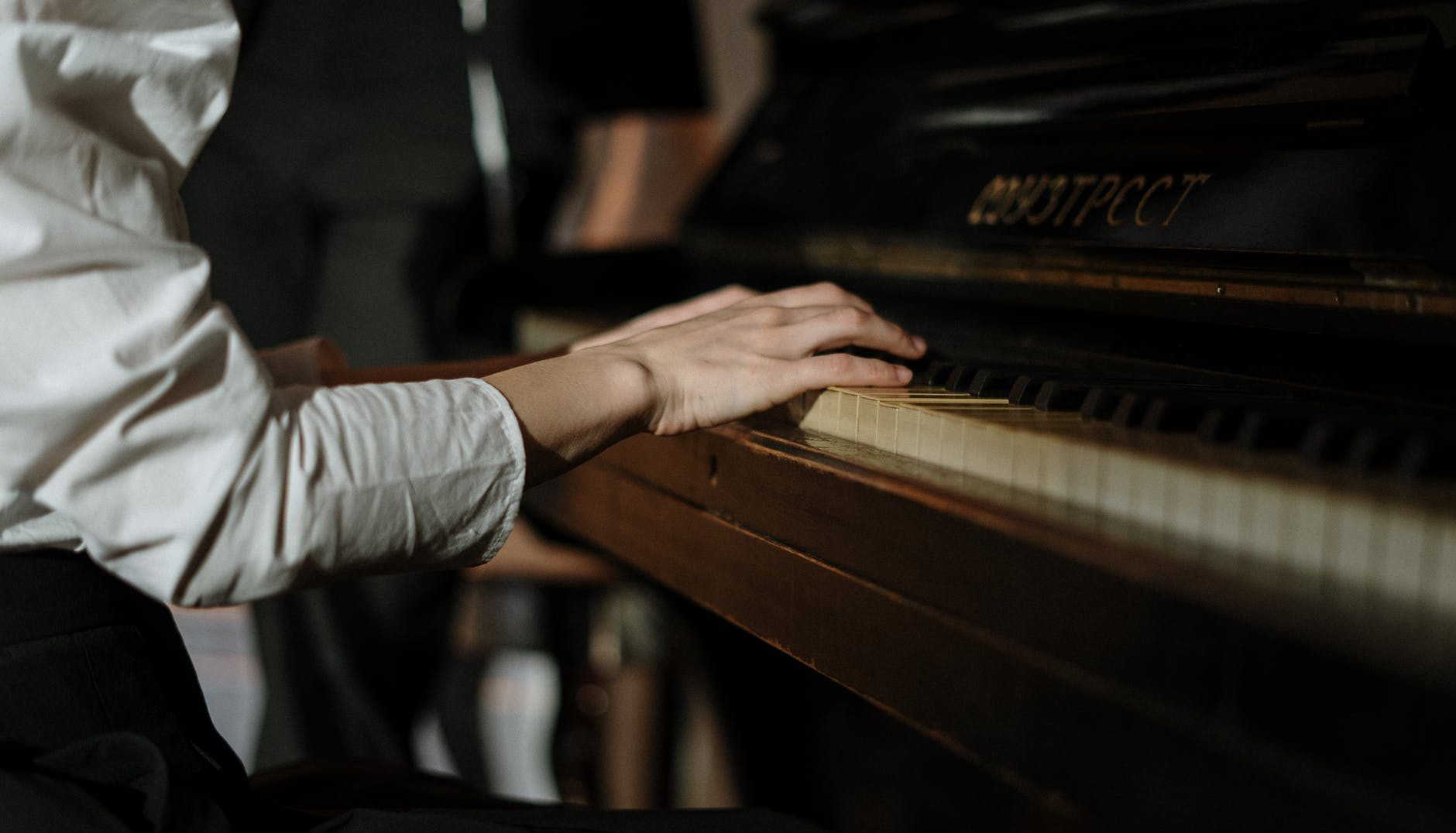 hands sitting music piano