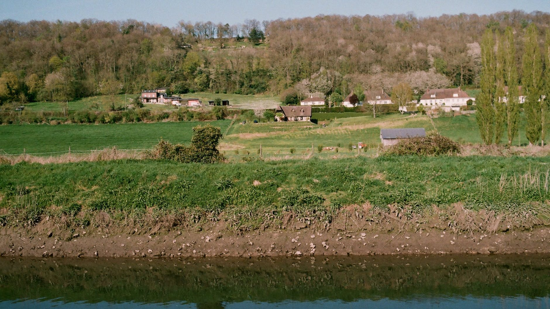 rural houses near lake in countryside